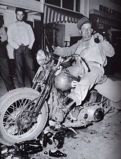 """""""Cyclist's Holiday: He and his friends terrorize a town."""" The famous, staged Barney Peterson photo"""