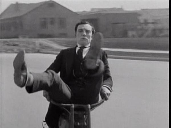 Keaton. Sherlock Jr. bike sit front